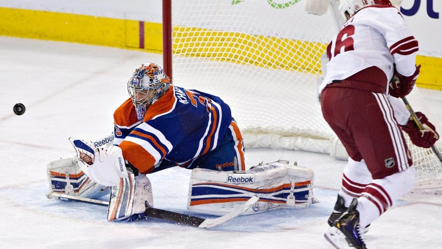 Phoenix Coyotes' Rostislav Klesla (16) is stopped by Edmonton Oilers goalie Nikolai Khabibulin (35) during the second period of an NHL hockey game in Edmonton, Alberta, on Saturday, Feb. 23, 2013. (AP Photo/The Canadian Press, Jason Franson)