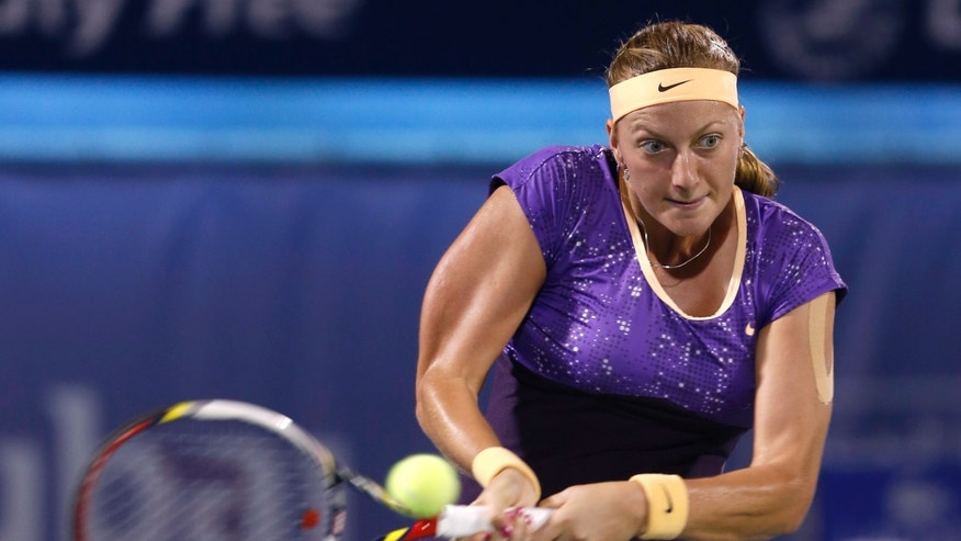 Petra Kvitova of Czech Republic serves to Sara Errani of Italy during the final of the Dubai Duty Free Tennis Championships in Dubai, United Arab Emirates, Saturday, Feb. 23, 2013. (AP Photo/Regi Varghese)