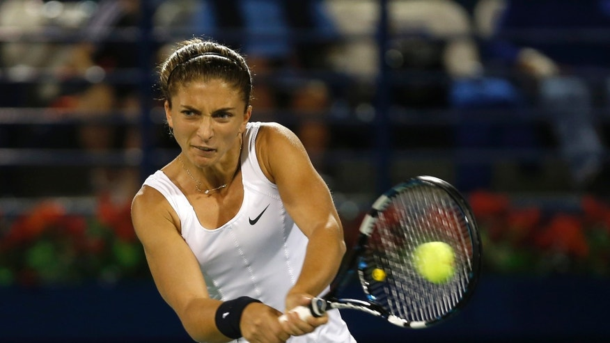 Sara Errani of Italy returns to Petra Kvitova of the Czech Republic during the final of the Dubai Duty Free Tennis Championships in Dubai, United Arab Emirates, Saturday, Feb. 23, 2013. (AP Photo/Regi Varghese)