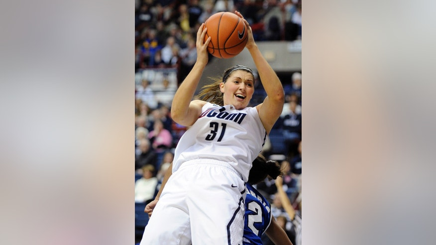 Connecticut's Stefanie Dolson is fouled by Seton Hall's Brittany Morris during the first half of an NCAA college basketball game in Storrs, Conn., Saturday, Feb. 23, 2013. (AP Photo/Fred Beckham)