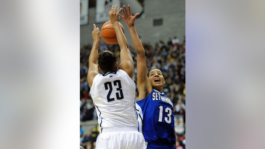 Seton Hall's Alexandra Maseko, right, guards Connecticut's Kaleena Mosqueda-Lewis during the first half of an NCAA college basketball game in Storrs, Conn., Saturday, Feb. 23, 2013. (AP Photo/Fred Beckham)