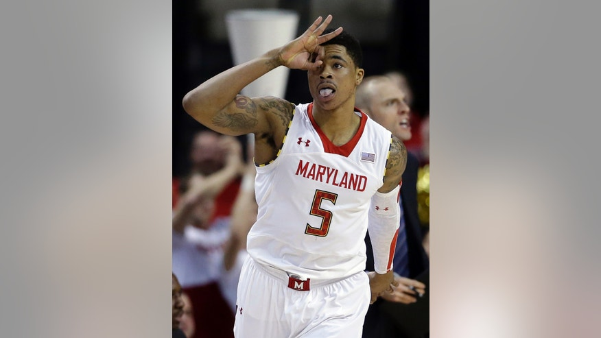 Maryland guard Nick Faust reacts after scoring a 3-pointer in the first half of an NCAA college basketball game against Clemson in College Park, Md., Saturday, Feb. 23, 2013. (AP Photo/Patrick Semansky)
