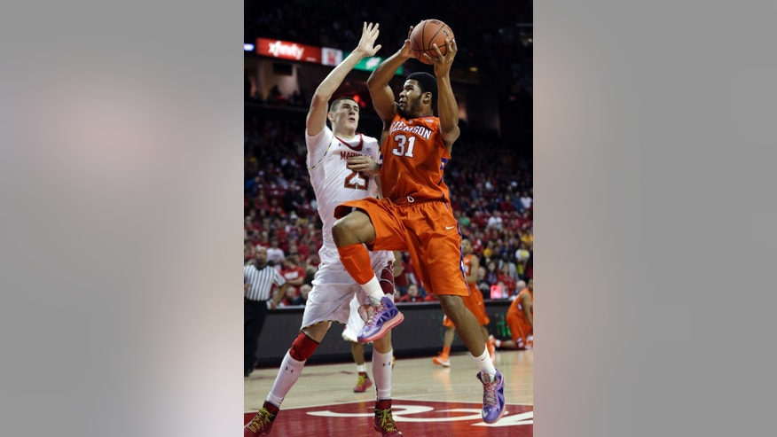 Clemson center Devin Booker, right, goes up for a shot against Maryland center Alex Len, of Ukraine, during the first half of an NCAA college basketball game in College Park, Md., Saturday, Feb. 23, 2013. (AP Photo/Patrick Semansky)