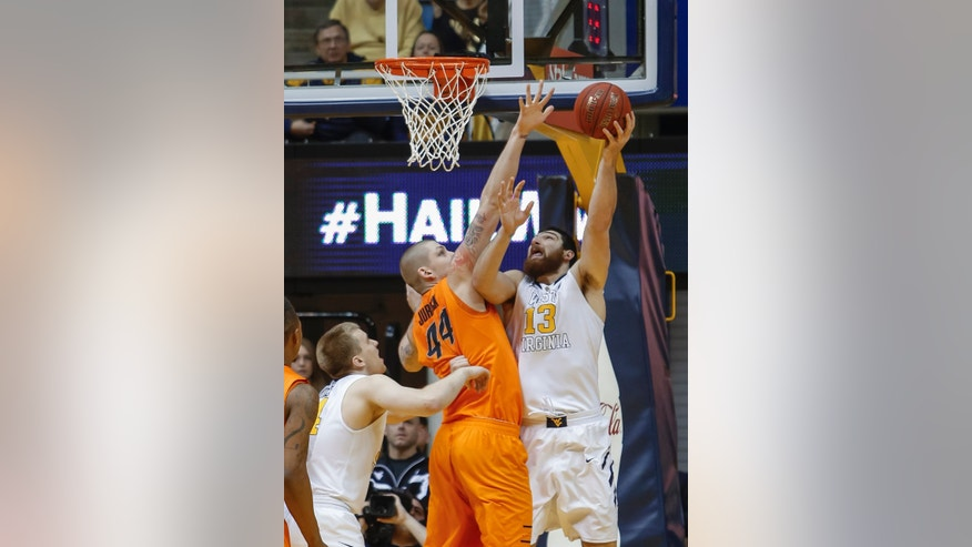 West Virginia's Deniz Kilicli (13) shoots over Oklahoma State's Philip Jurick during the first half of an NCAA college basketball game in Morgantown, W.Va., on Saturday, Feb. 23, 2013. (AP Photo/David Smith)