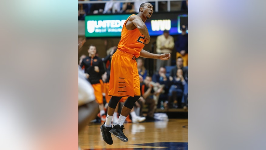 Oklahoma State's Markel Brown (22) celebrates after scoring during the first half of an NCAA college basketball game in Morgantown, W.Va., on Saturday, Feb. 23, 2013. (AP Photo/David Smith)