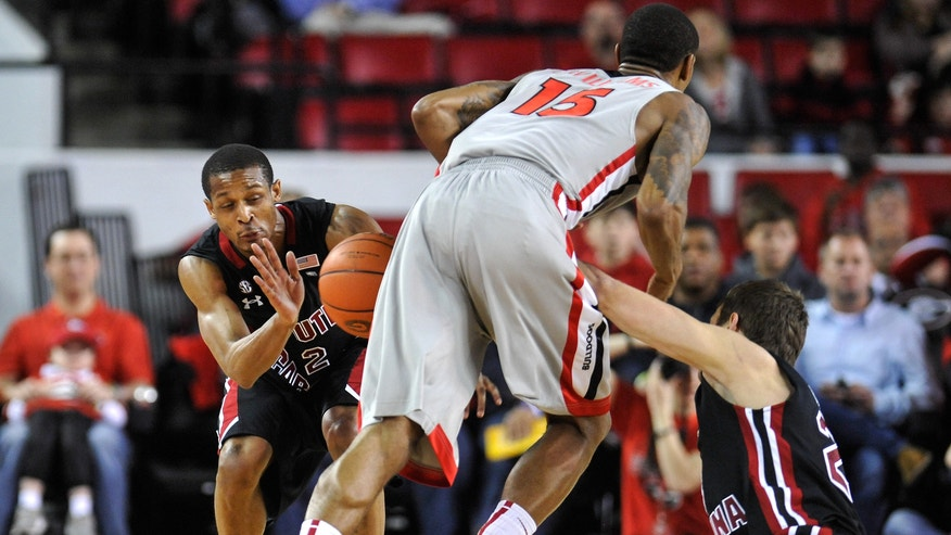 South Carolina guard Brian Richardson (2) and forward Mindaugas Kacinas (25) steal the ball from Georgia forward Donte' Williams (15) during the first half of an NCAA college basketball game in Athens, Ga., Saturday, Feb. 23, 2013. (AP Photo/The Banner-Herald, AJ Reynolds)