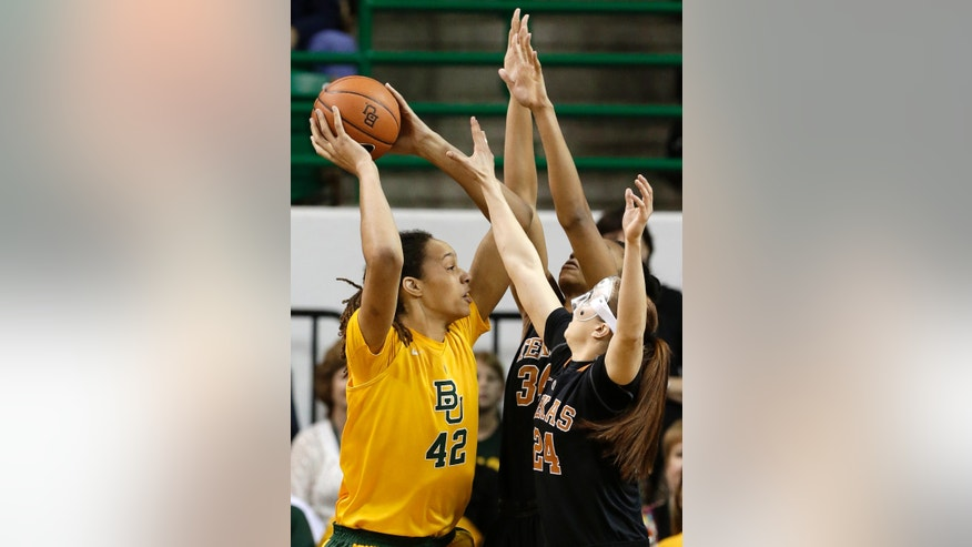 Baylor center Brittney Griner (42) looks for a shot opportunity as Texas' Chassidy Fussell (24) and Imani McGee-Stafford (34) defend in the first half of an NCAA college basketball game Saturday, Feb. 23, 2013, in Waco, Texas. (AP Photo/Tony Gutierrez)