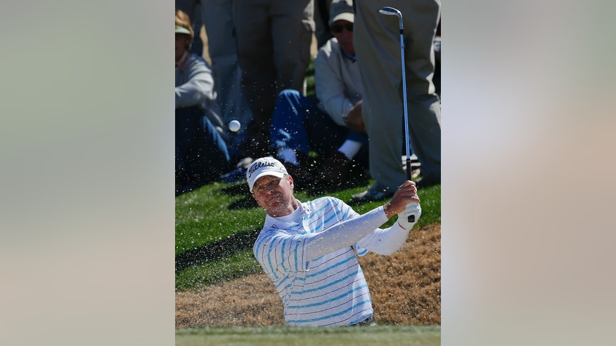 Steve Stricker hits out of a bunker on the second hole in the quarterfinal round of play against Ian Poulter during the Match Play Championship golf tournament, Saturday, Feb. 23, 2013, in Marana, Ariz. (AP Photo/Ross D. Franklin)