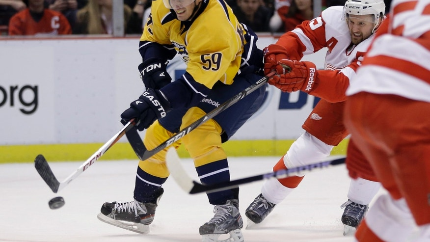 Detroit Red Wings defenseman Niklas Kronwall (55), of Sweden, chases Nashville Predators defenseman Roman Josi (59), of Switzerland, during the first period of an NHL hockey game in Detroit, Saturday, Feb. 23, 2013. (AP Photo/Carlos Osorio)