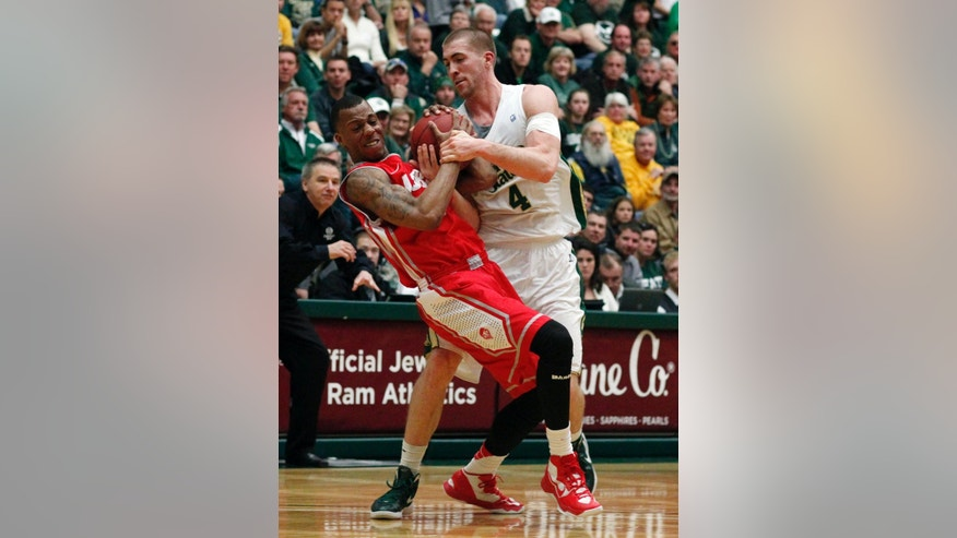 New Mexico guard Chad Adams, left, gets tied up with Colorado State forward Pierce Hornung as they fight for control of a loose ball in the first half of an NCAA basketball game in Fort Collins, Colo., on Saturday, Feb. 23, 2013. (AP Photo/David Zalubowski)