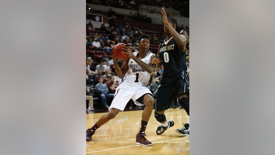 Mississippi State guard Fred Thomas (1) leans into Vanderbilt forward Rod Odom (0) as he attempts a shot at the basket in the first half of their NCAA college basketball game in Starkville, Miss., Saturday, Feb. 23, 2013.  (AP Photo/Rogelio V. Solis)