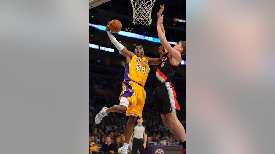 Los Angeles Lakers guard Kobe Bryant, left, goes up for a shot as Portland Trail Blazers center Meyers Leonard defends during the first half of their NBA basketball game, Friday, Feb. 22, 2013, in Los Angeles. (AP Photo/Mark J. Terrill)