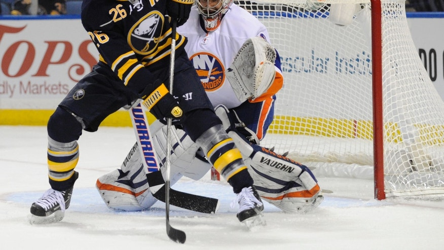 Buffalo Sabres' left winger Thomas Vanek (26), of Austria, gets ready to deflect the puck in front of New York Islanders' goaltender Evgeni Nabokov (20), of Russia, during the first period of an NHL hockey game in Buffalo, N.Y., Saturday, Feb. 23, 2013. (AP Photo/Gary Wiepert)