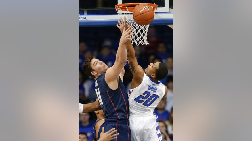 Connecticut forward Tyler Olander, left, and DePaul guard Brandon Young look back for a rebound during the first half of an NCAA college basketball game in Rosemont, Ill., on Saturday, Feb. 23, 2013. (AP Photo/Nam Y. Huh)
