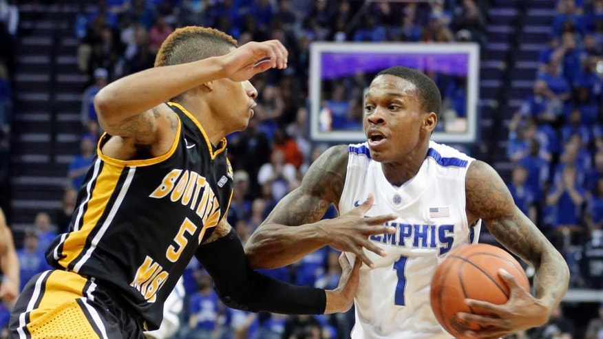 Memphis' Joe Jackson (1) is pressured by Southern Miss' Neil Watson (5) during the first half of an NCAA college basketball game in Memphis, Tenn., Saturday, Feb. 23, 2013. (AP Photo/Danny Johnston)