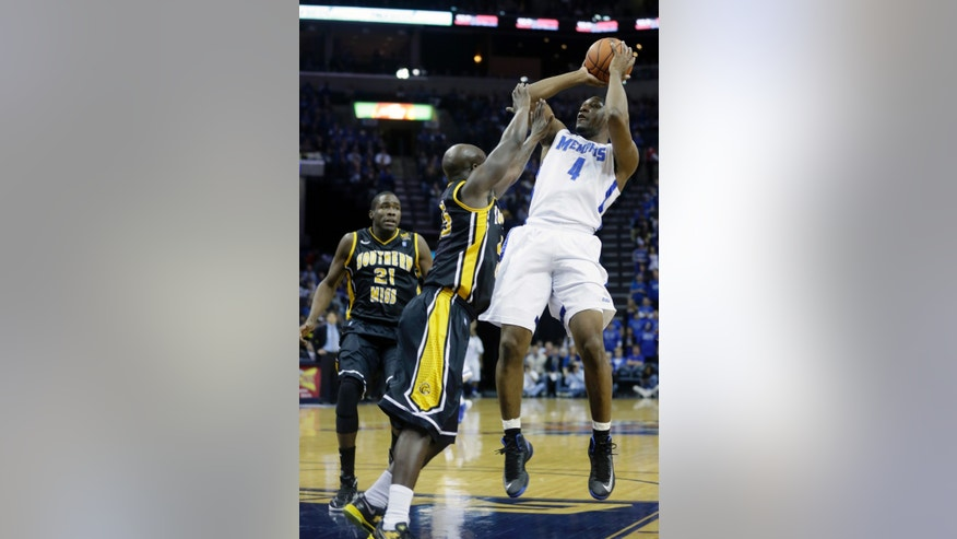 Memphis' Adonis Thomas (4) makes a shot over Southern Miss' Jerrold Brooks, center, and Norville Carey (21) during the first half of an NCAA basketball game in Memphis, Tenn., Saturday, Feb. 23, 2013. (AP Photo/Danny Johnston)