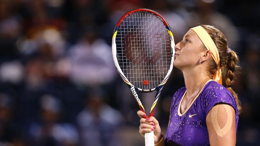 Petra Kvitova of Czech Republic reacts during her match against Sara Errani of Italy during the final of the Dubai Duty Free Tennis Championships in Dubai, United Arab Emirates, Saturday, Feb. 23, 2013. (AP Photo/Regi Varghese)