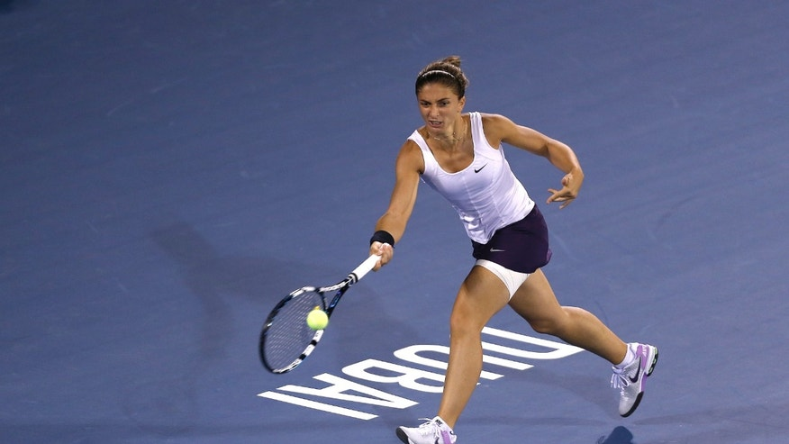 Sara Errani of Italy returns to Petra Kvitova of Czech Republic during the final of the Dubai Duty Free Tennis Championships in Dubai, United Arab Emirates, Saturday, Feb. 23, 2013. (AP Photo/Regi Varghese)
