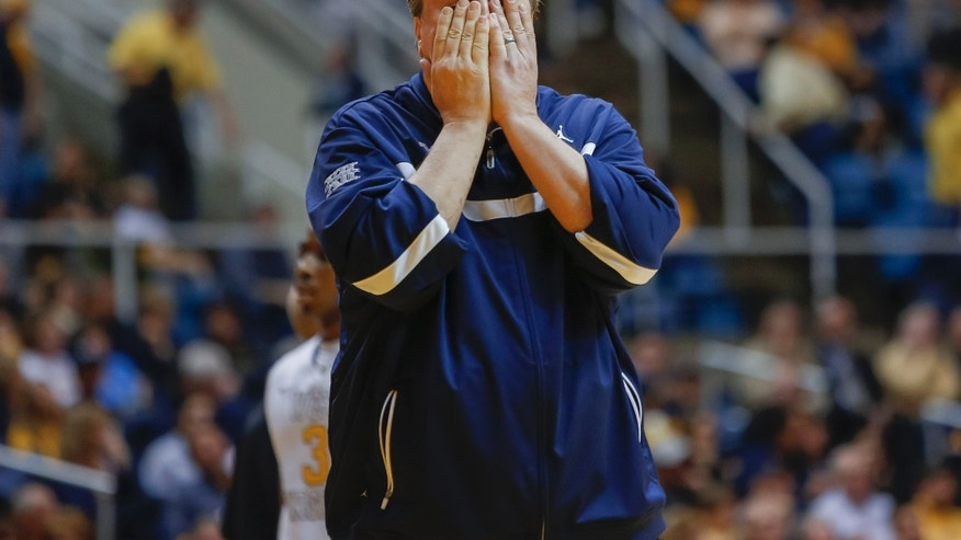 West Virginia coach Bob Huggins reacts to his team's play during the second half of an NCAA college basketball game in Morgantown, W.Va., on Saturday, Feb. 23, 2013. Oklahoma State defeated West Virginia 73-57. (AP Photo/David Smith)