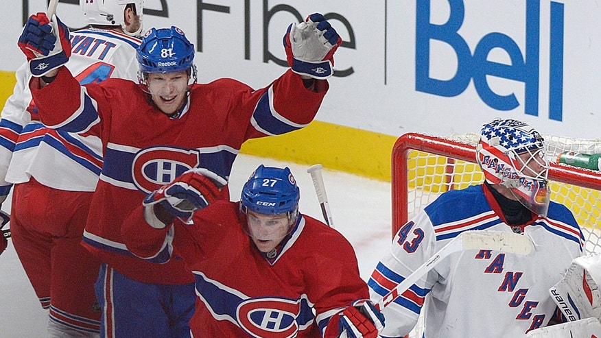 Montreal Canadiens' Alex Galchenyuk (27) and Lars Eller (81) celebrate Galchenyuk's goal against New York Rangers goaltender Martin Biron, right, during the second period of an NHL hockey game in Montreal, Saturday, Feb. 23, 2013. (AP Photo/The Canadian Press, Graham Hughes)