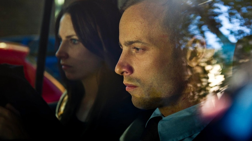 Olympic athlete Oscar Pistorius, right, and his sister Aimee, left, are driven to a relatives home in Pretoria, South Africa, Friday, Feb. 22, 2013. Pistorius was released on bail and will return to court June, 4, 2013 to face charge a charge of pre-meditated murder in the shooting death of his girlfriend, Reeva Steenkamp. (AP Photo/Nelius Rademan-FOTO24-Beeld) SOUTH AFRICA OUT NO SALES. NO ARCHIVE, ONLINE OUT MAGAZINES OUT INTERNET OUT TV OUT