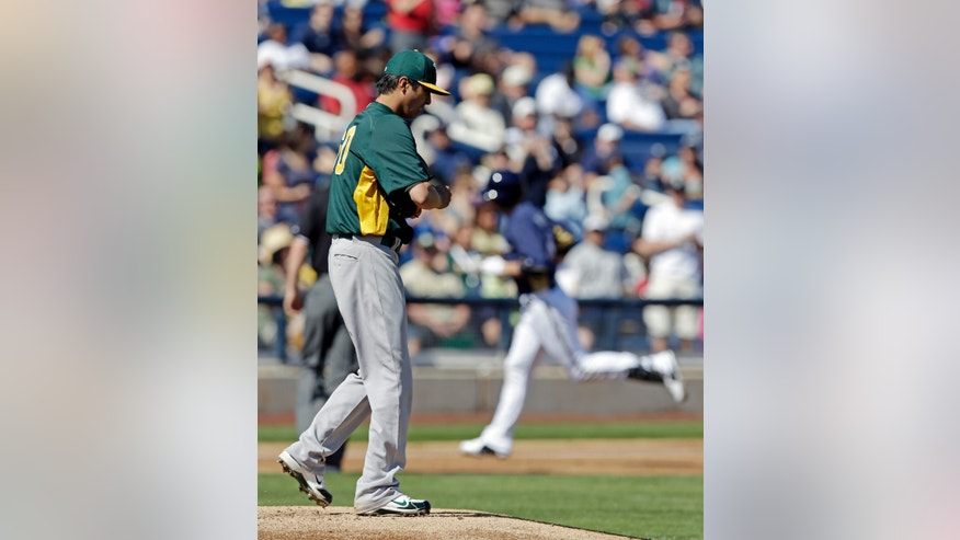Oakland Athletics' Jesse Chavez reacts after giving up a home run to Milwaukee Brewers' Ryan Braun during the first inning of an exhibition spring training baseball game Saturday, Feb. 23, 2013, in Phoenix. (AP Photo/Morry Gash)