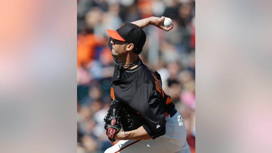San Francisco Giants' Ryan Vogelsong throws during the first inning of an exhibition spring training baseball game against the Los Angeles Angels Saturday, Feb. 23, 2013, in Scottsdale, Ariz. (AP Photo/Darron Cummings)