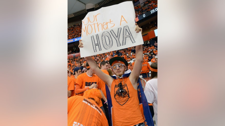 Syracuse fan Max Lefkowitz holds a sign Syracuse's NCAA college basketball game against Georgetown in Syracuse, N.Y., Saturday, Feb. 23, 2013. (AP Photo/Kevin Rivoli)