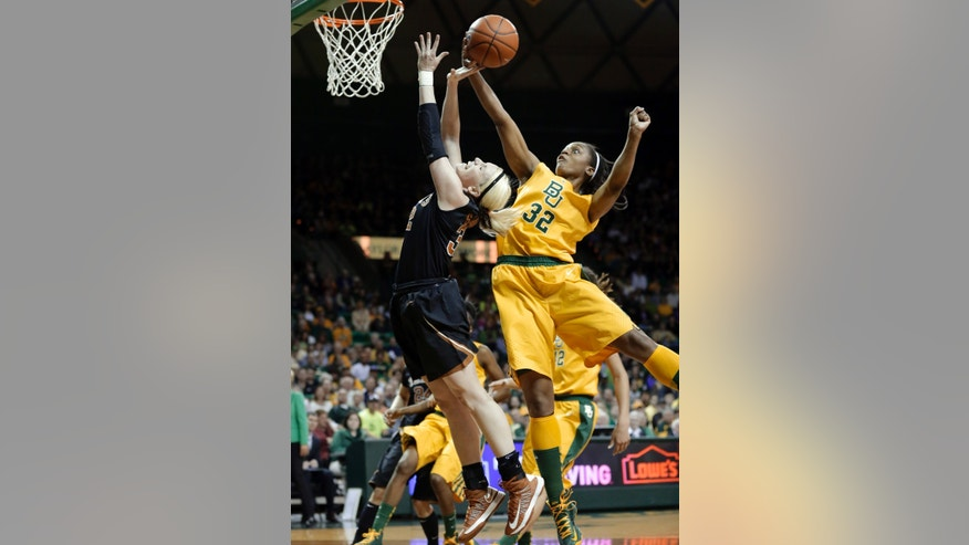 Texas 's Brady Sanders, left, has her shot blocked by Baylor forward Brooklyn Pope (32) during the first half of an NCAA college basketball game Saturday, Feb. 23, 2013, in Waco, Texas. (AP Photo/Tony Gutierrez)