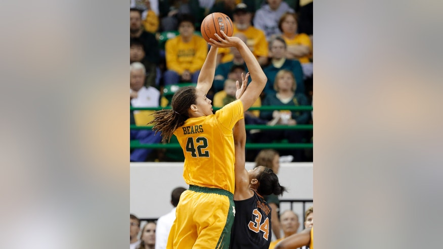 Baylor center Brittney Griner (42) shoots over Texas' Imani McGee-Stafford (34) in the first half of an NCAA college basketball game Saturday, Feb. 23, 2013, in Waco, Texas. (AP Photo/Tony Gutierrez)