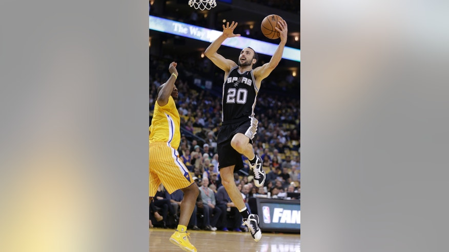 San Antonio Spurs' Manu Ginobli (20) goes to the basket next to Golden State Warriors' Carl Landry during the first half of an NBA basketball game Friday, Feb. 22, 2013, in Oakland, Calif. (AP Photo/Ben Margot)