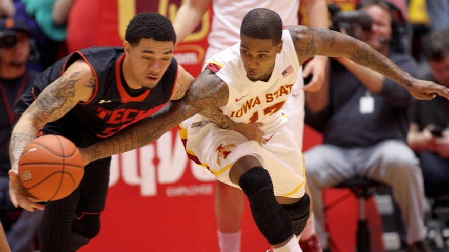 Iowa State guard Korie Lucious (13) tries to steal the ball from Texas Tech guard Josh Gray (5) during the first half of an NCAA college basketball game, Saturday, Feb. 23, 2013, in Ames, Iowa. Lucious was called for a foul on the play. (AP Photo/Justin Hayworth)