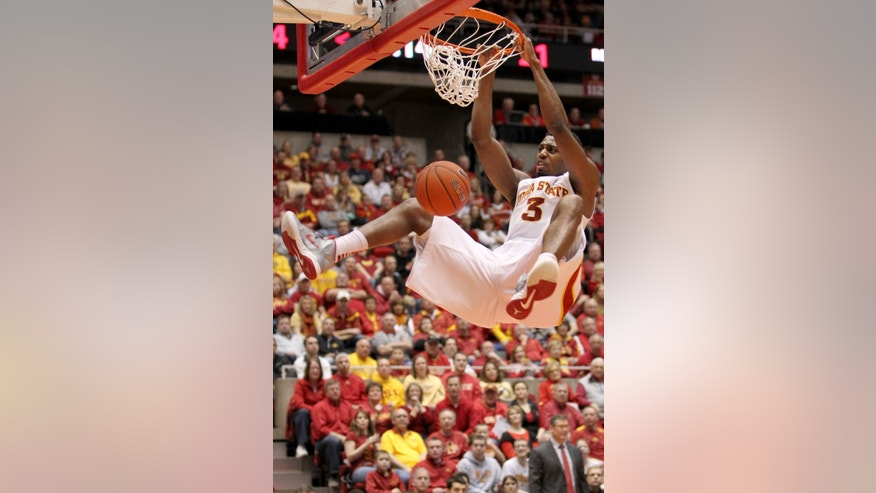 Iowa State forward Melvin Ejim (3) slams the ball during the first half of an NCAA college basketball game against Texas Tech, Saturday, Feb. 23, 2013, in Ames, Iowa. (AP Photo/Justin Hayworth)