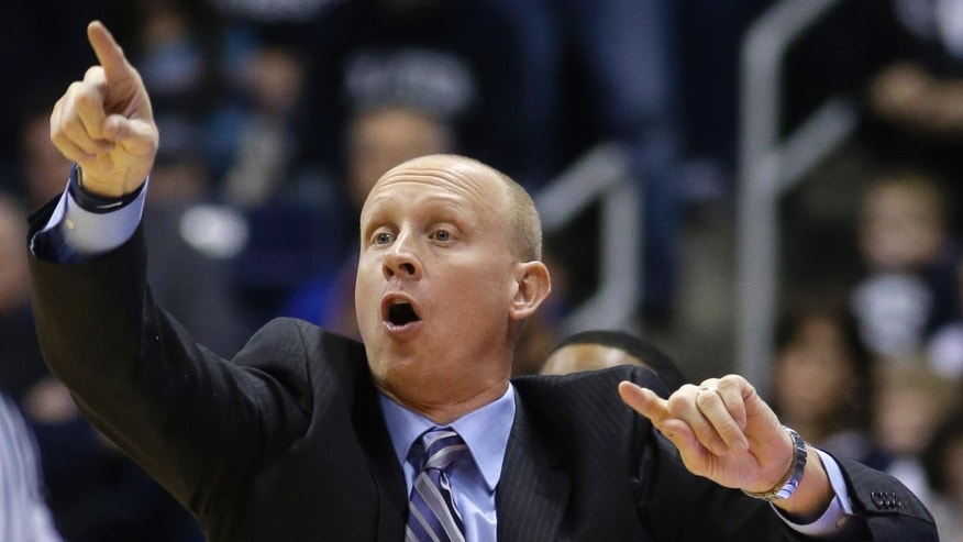 Xavier head coach Chris Mack yells instructions in the first half of an NCAA college basketball game against Virginia Commonwealth, Saturday, Feb. 23, 2013, in Cincinnati. (AP Photo/Al Behrman)