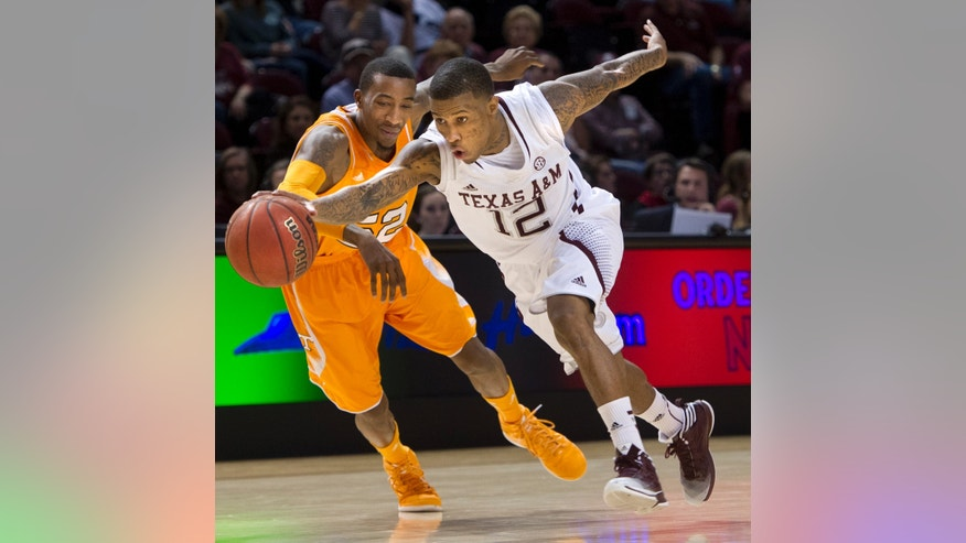 Texas A&M's Fabyon Harris (12) drives past Tennessee's Jordan McRae during the first half of an NCAA college basketball game in College Station, Texas, Saturday, Feb. 23, 2013. (AP Photo/Bryan College Station Eagle, Stuart Villanueva)