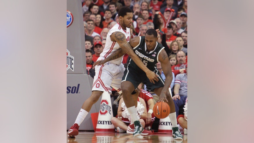 Michigan State's Derrick Nix, right, posts up against Ohio State's Amir Williams during the first half of an NCAA college basketball game Sunday, Feb. 24, 2013, in Columbus, Ohio. (AP Photo/Jay LaPrete)