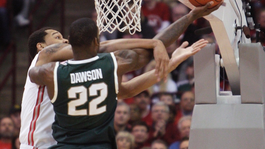 Ohio State's Amir Williams, left, fouls Michigan State's Branden Dawson during the first half of an NCAA college basketball game Sunday, Feb. 24, 2013, in Columbus, Ohio. (AP Photo/Jay LaPrete)