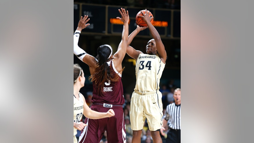 Vanderbilt center Tiffany Clarke shoots over Texas A&M defender Kelsey Bone during an NCAA college basketball game Sunday, Feb. 24, 2013, in Nashville, Tenn. Clarke scored a career-high 30 points as Vanderbilt won 61-51. (AP Photo/Joe Howell)