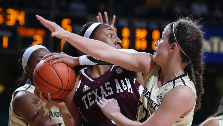 Texas A&M center Kelsey Bone pulls down a rebound in front of Vanderbilt guard Gabby Smith during the first half of an NCAA college basketball game Sunday, Feb. 24, 2013, in Nashville, Tenn. (AP Photo/Joe Howell)