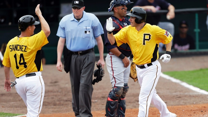 Pittsburgh Pirates' Clint Barmes, right, celebrates with Gaby Sanchez, left, after hitting a home run during the fifth inning of a baseball spring training exhibition game against the Atlanta Braves, Sunday, Feb. 24, 2013, in Bradenton, Fla. (AP Photo/Charlie Neibergall)