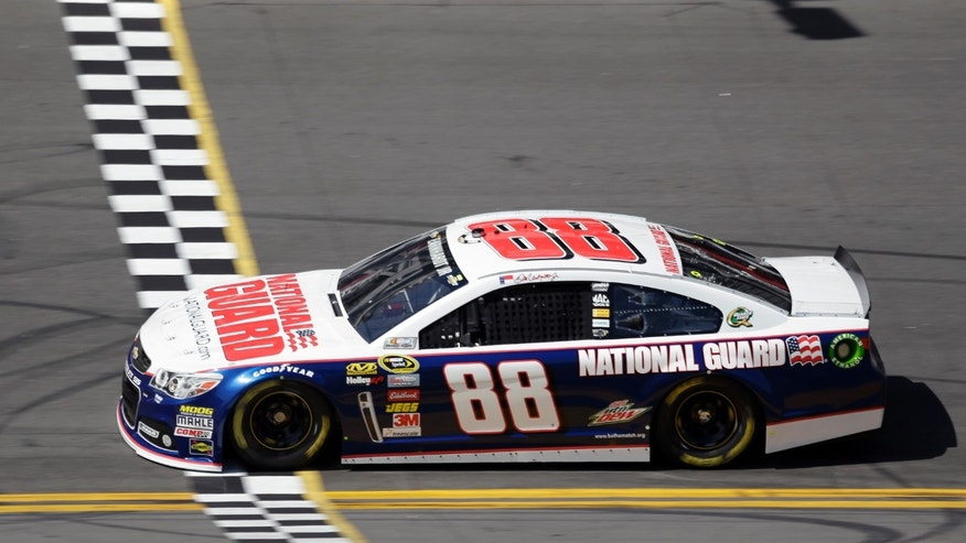 Dale Earnhardt Jr., crosses the start/finish line during a Daytona 500 NASCAR Spring Cup Series auto race practice Wednesday, Feb. 20, 2013, in Daytona Beach, Fla. (AP Photo/Chris O'Meara)