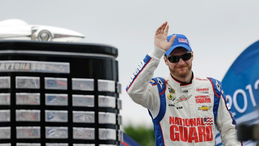 Dale Earnhardt Jr., waves to fans during driver introductions before the NASCAR Daytona 500 Sprint Cup Series auto race at Daytona International Speedway, Sunday, Feb. 24, 2013, in Daytona Beach, Fla. (AP Photo/John Raoux)