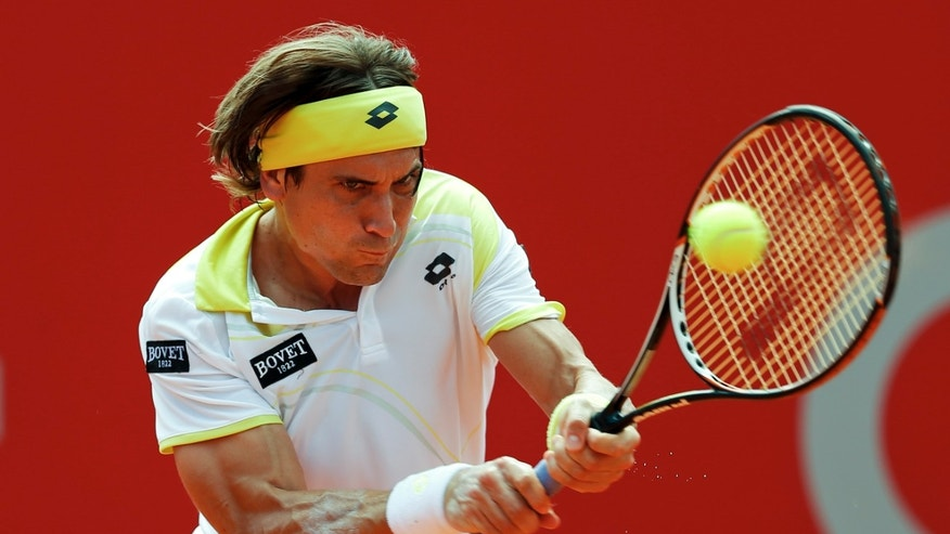 Spain's David Ferrer returns the ball to Stanislas Wawrinka of Switzerland during the Claro Cup tennis final in Buenos Aires, Argentina, Sunday, Feb. 24, 2013. (AP Photo/Victor R. Caivano)