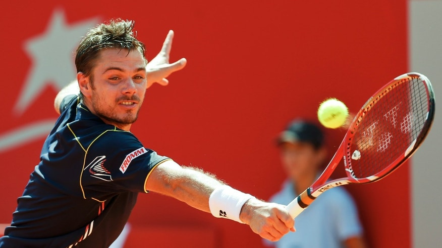 Stanislas Wawrinka of Switzerland returns a ball to Spain's David Ferrer during the Claro Cup final in Buenos Aires, Argentina,  Sunday, Feb. 24, 2013. (AP Photo/Victor R. Caivano)