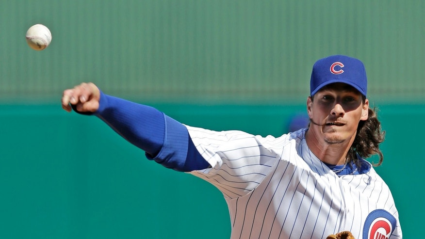 Chicago Cubs' Jeff Samardzija warms up for a spring training baseball game against the San Francisco Giants on Sunday, Feb. 24, 2013, in Mesa, Ariz. (AP Photo/Morry Gash)