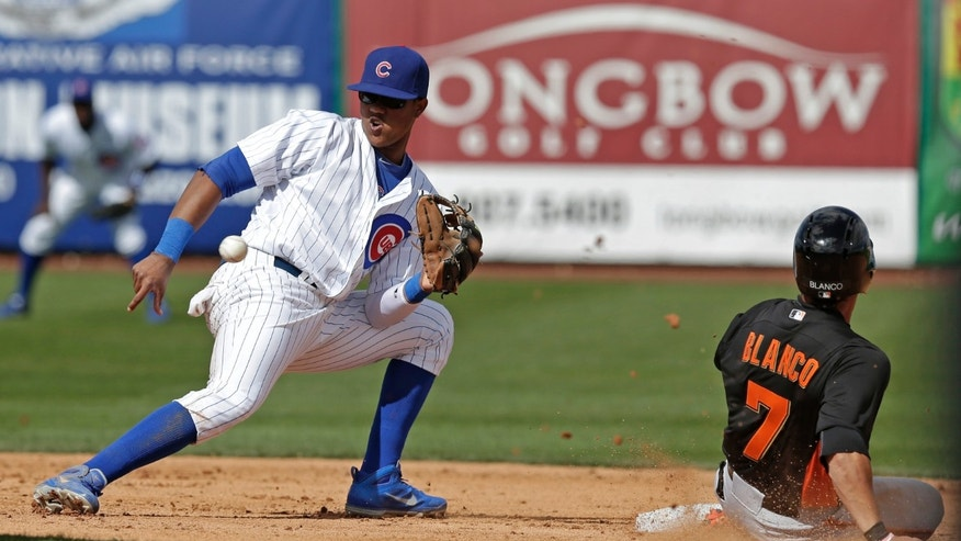 San Francisco Giants' Gregor Blanco (7) steals second with Chicago Cubs' Starlin Castro covering during the third inning of a spring training baseball game Sunday, Feb. 24, 2013, in Mesa, Ariz. (AP Photo/Morry Gash)