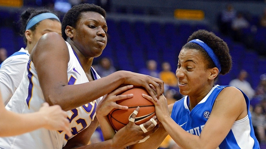 LSU forward Shanece McKinney, left, and Kentucky guard Kastine Evans vie for control of a rebound during the first half of an NCAA college basketball game in Baton Rouge, La., Sunday, Feb. 24, 2013. (AP Photo/Bill Feig)