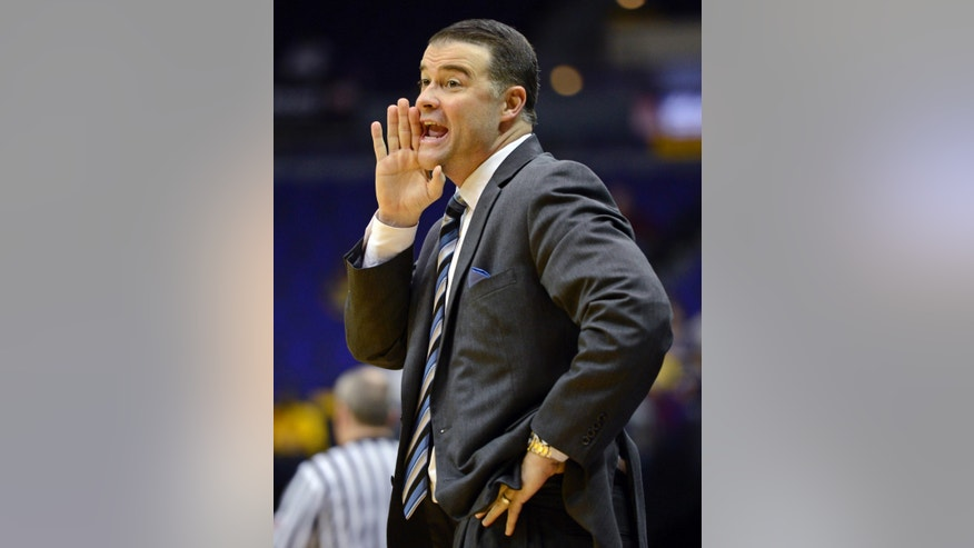 Kentucky coach Matthew Mitchell shouts instructions to his players during the first half of an NCAA college basketball game against LSU in Baton Rouge, La., Sunday, Feb. 24, 2013. (AP Photo/Bill Feig)