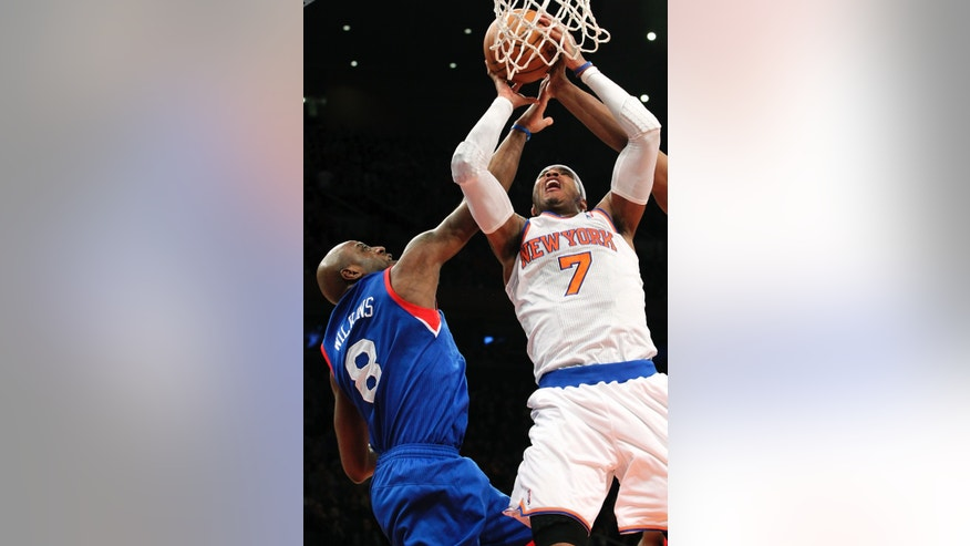 New York Knicks' Carmelo Anthony (7) goes up against Philadelphia 76ers' Damien Wilkins during the first half of an NBA basketball game, Sunday, Feb. 24, 2013, at Madison Square Garden in New York. (AP Photo/Mary Altaffer)