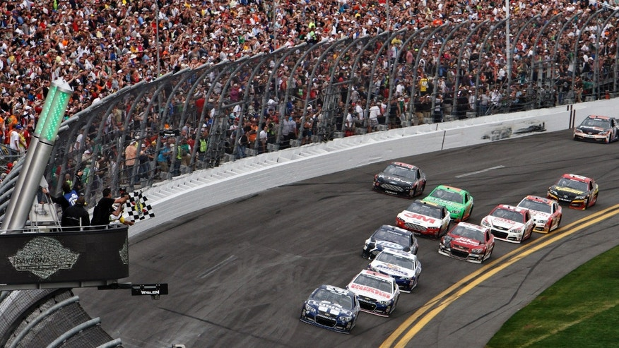 Jimmie Johnson (48) leads Dale Earnhardt Jr., (88) and Mark Martin (55) to the checkered flag to win the Daytona 500 NASCAR Sprint Cup Series auto race, Sunday, Feb. 24, 2013, at Daytona International Speedway in Daytona Beach, Fla. (AP Photo/David Graham)